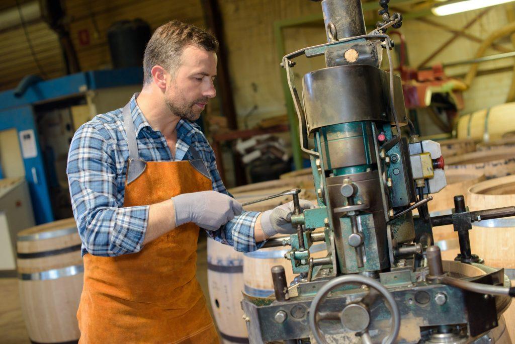 Cooper using machinery