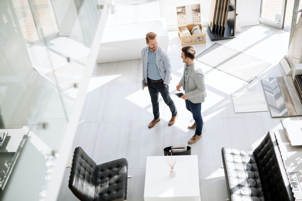 Customers entering interior design store