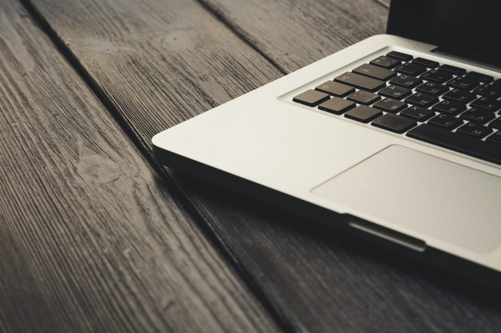 Laptop on modern wooden desk