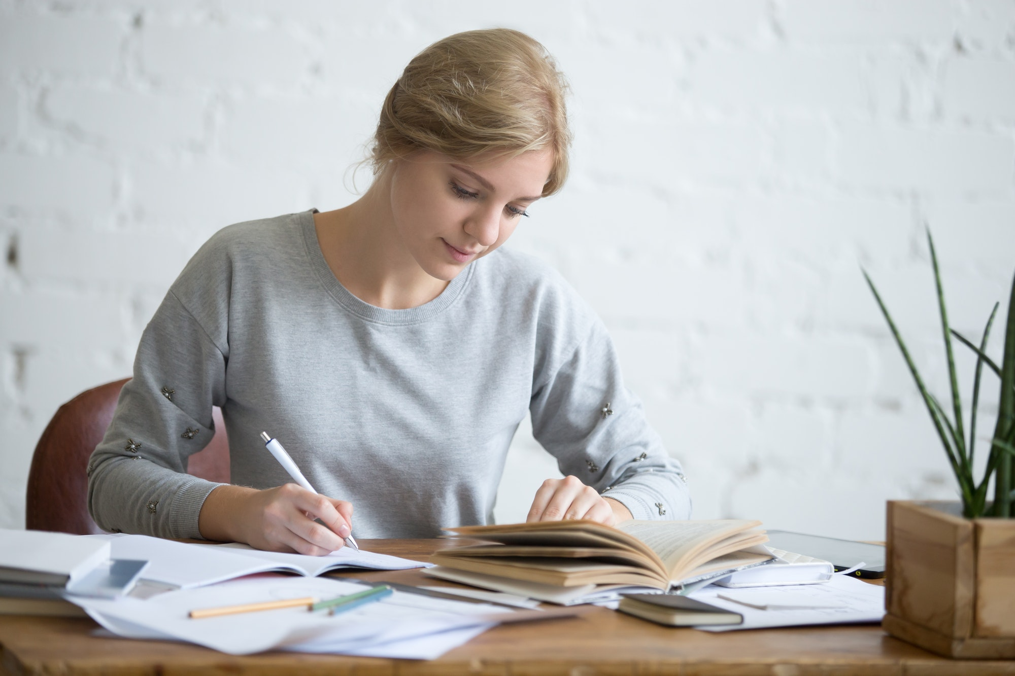 Student female performing a written task in a copybook